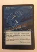Based on the MTGO Cube/ Vintage Champs artwork, with border extension on Masques Brainstorm.  2/4 of a playset
