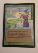 Black bordered and featuring a pop out of the wizard who is summoning gush from afar.  Currently in my vintage deck